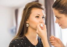 Closeup of a makeup artist at work Royalty Free Stock Photos