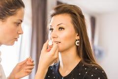 Closeup of a makeup artist at work Stock Photography