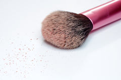 Closeup of makeup brush and blush on white background Royalty Free Stock Images