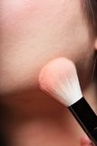 Closeup makeup. Cosmetic Powder Brush. Stock Photos