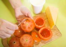 Closeup of  making stuffed tomato Stock Image