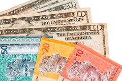 Closeup of Malaysia Ringgit and American US Dollar Royalty Free Stock Photography