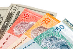 Closeup of Malaysia Ringgit and American US Dollar Stock Images