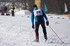 Closeup of a male athlete skier during the race Les classic style in the championship . Closeup of a male athlete skier during the race Les classic style in the Stock Photo
