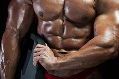 Closeup of male bodybuilder abdominal muscles. Closeup of male abdominal muscles. Muscular high level bodybuilder with perfect trained body. High resolution stock images
