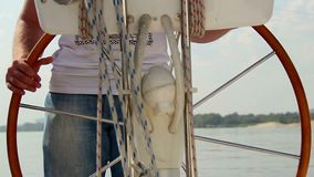 Closeup male captain steering boat on river, sailing, yachting. Stock footage stock video footage