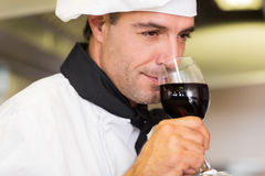Closeup of a male chef smelling red wine Stock Images