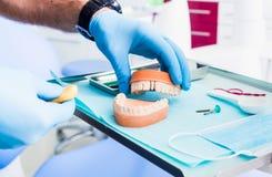 Closeup of male dental technician working in dental laboratory.dental acrylic prosthesis Stock Photo
