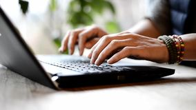 Closeup of male doctor hands typing on keyboard. stock footage