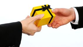Closeup  of male executive handing gift to female  Stock Photography