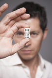 Closeup Of Male Executive Holding Dice Stock Photo
