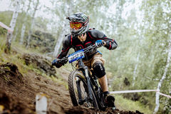 Closeup of male extreme racer bike. Magnitogorsk, Russia - July 23, 2016: closeup of male extreme racer bike during National championship downhill royalty free stock photo