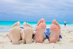 Closeup male and female feet on white sand Stock Photo
