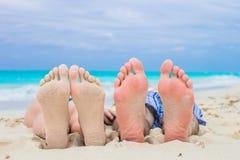 Closeup male and female feet on white sand. Close up male and female feet on white sand beach Royalty Free Stock Image