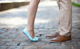 Closeup of male and female legs at a date Stock Photos