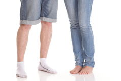 Closeup of male and female legs during a date Stock Photo