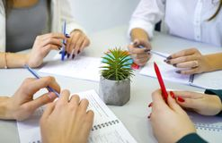 Closeup male and female student hands with pens and notebooks on table. People, education, knowledge, cooperation, study, conversation concept royalty free stock photos