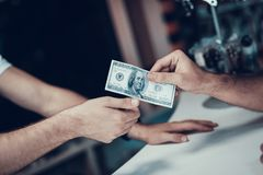 Closeup of Male Hand Gives Money to Seller stock photo