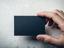 Closeup of male hand holding black business card Stock Image