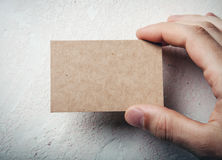 Closeup of male hand holding craft business card stock images