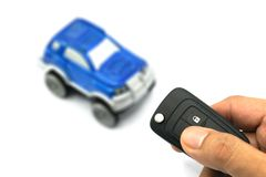 Right hand holding remote control car key for business concept Royalty Free Stock Photos