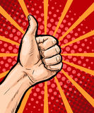Closeup of male hand showing thumbs up sign on pop art background. Pop Art poster. Pop Art background. isolated, message, support, Royalty Free Stock Photography