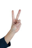 Closeup of male hand showing victory sign on white background. Closeup of male hand showing victory sign with two fingers against white background Stock Photography