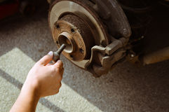 Closeup of male hand working with disk and brake Stock Photos