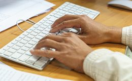 Closeup of a male hands busy typing on a keyboard computer. Technology concept. office concept Stock Images