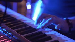 Closeup Of Male Hands Playing Piano. Man Playing The Synthesizer Keyboard. Man Plays Music Keyboard. Musician Plays stock video