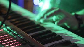 Closeup Of Male Hands Playing Piano. Man Playing The Synthesizer Keyboard. Man Plays Music Keyboard. Musician Plays. Piano. A Musician Playing A Musical Royalty Free Stock Image