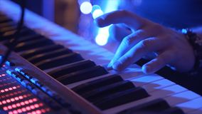 Closeup Of Male Hands Playing Piano. Man Playing The Synthesizer Keyboard. Man Plays Music Keyboard. Musician Plays. Piano. A Musician Playing A Musical Royalty Free Stock Photo