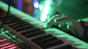 Closeup Of Male Hands Playing Piano. Man Playing The Synthesizer Keyboard. Man Plays Music Keyboard. Musician Plays royalty free stock image