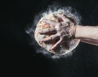 Closeup of male hands put fresh bread on black background with copy space for your text Royalty Free Stock Photos