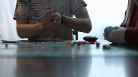 Young man rolling the dices for gambling stock footage