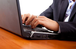 Closeup of male hands typing on a laptop Stock Photography