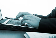 Closeup of male hands typing on a laptop Royalty Free Stock Photo