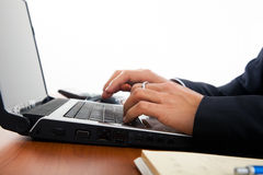 Closeup of male hands typing on a laptop Royalty Free Stock Photography
