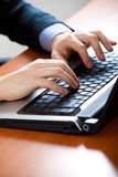 Closeup of male hands typing on a laptop Royalty Free Stock Photos