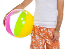 Closeup on male holding beach ball Stock Photo