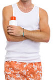 Closeup on male holding sun screen creme Royalty Free Stock Photography