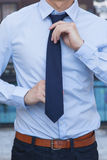 Closeup of Male office worker tying a tie Royalty Free Stock Photos