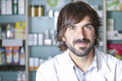 Closeup of a male pharmacist. With friendly look at the pharmacy - focus on the face Stock Images