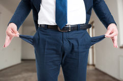 Closeup of male realtor showing his empty pockets Royalty Free Stock Photography