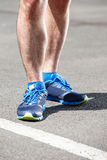Closeup of a male runner feet. Closeup of a male runner standing - space for text. Fitness concept Royalty Free Stock Photos