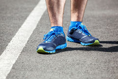 Closeup of a male runner feet. Royalty Free Stock Photos