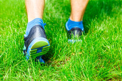 Closeup of a male runner standing in grass. Closeup of a male runner standing - space for text. Fitness concept Stock Images