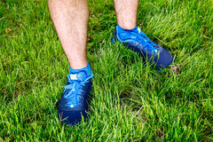 Closeup of a male runner standing in grass. Closeup of a male runner standing - space for text. Fitness concept Stock Photography