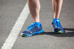 Closeup of a male runner standing Stock Photo