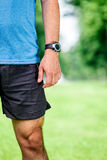 Closeup of a male runner standing -. Space for text. Fitness concept Stock Photos
